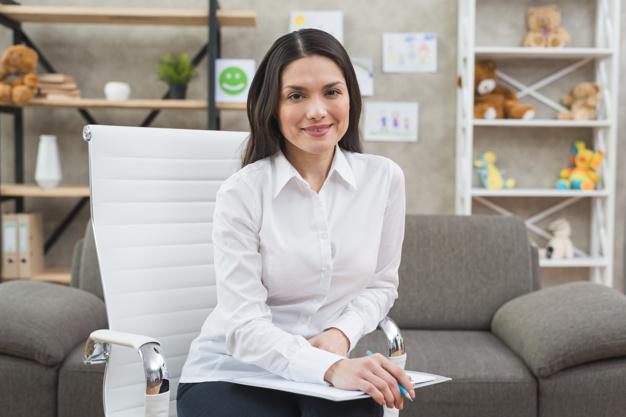 portrait-smiling-female-psychologist-her-office_23-2148026254